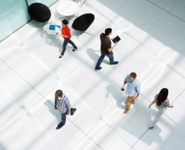 People walking on office concourse --- Image by © Igor E./Image Source/Corbis
