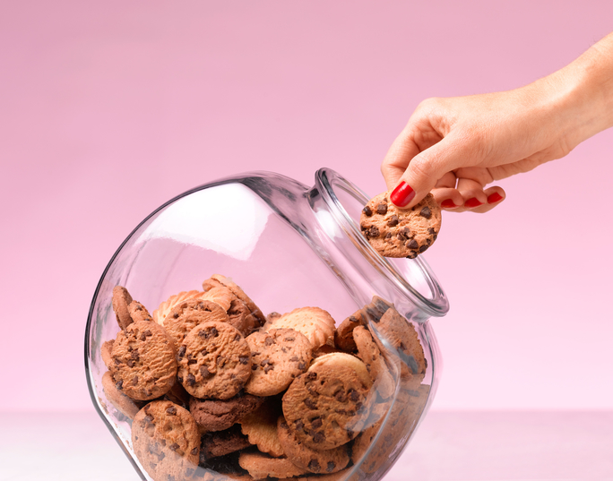 Temptation - hand in a cookie jar