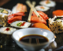 Sushi Assortment on Black Plate, Close-up