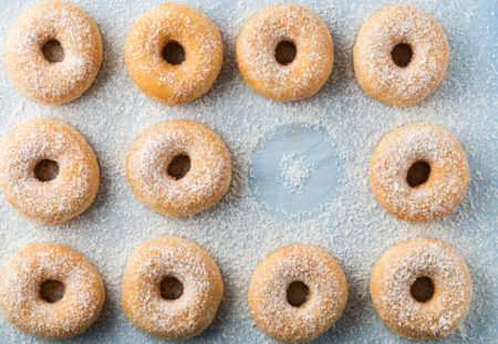 Doughnuts sprinkled with icing sugar